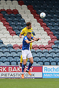 AFC Wimbledon midfielder Chris Whelpdale (11) and Rochdale FC defender Jim McNulty (4) during the EFL Sky Bet League 1 match between Rochdale and AFC Wimbledon at Spotland, Rochdale, England on 27 August 2016. Photo by Stuart Butcher.