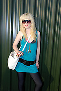 Girl with bleached hair, big black belt and sunglasses, Metro Weekender, Get Loaded In The Park, London 2006