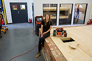Dayna in the workshop. Q-bot, underfloor insulation reducing carbon emissions potentially for 12 million households in the UK.   Q-Bot allows under-floor insulation to be installed at a much lower cost and without the disruption of existing methods by using a small robot that goes under the floor instead of having to take the floor up. © Andy Aitchison/ Ashden