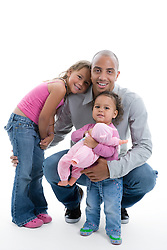 Portrait of little girls with their father in the studio,