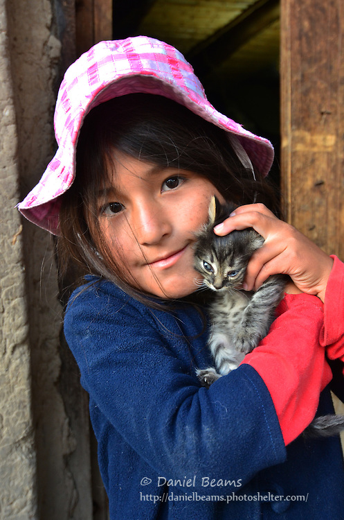 Quechua girl with kitten in Vacas, Cochabamba, Bolivia