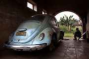 An old Volkswagon Beetle sits in the garage of a residential home at Km 7 of Yamgambi Research Station, in Yamgambi, DR Congo, on Sunday, Dec. 7, 2008. The station contains 250 residential homes, some are derelict but most are inhabited by more than one family. These are usually workers at the facility who are assigned the homes by the Ministry of Agriculture in Kinshasa.