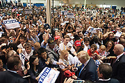 Donald Trump made his first visit to metro Atlanta as a presidential candidate, stopping by the North Atlanta Trade Center in Norcross on Saturday.<br /> <br /> The real-estate tycoon was originally scheduled to appear in August at Erick Erickson&rsquo;s Red State Gathering to deliver the event&rsquo;s keynote address to conservative activists. But the right-wing pundit and talk radio host withdrew Trump&rsquo;s invitation after he said a female Fox News anchor who asked him a difficult question during the first GOP presidential debate as having &ldquo;blood coming out of her eyes. Blood coming out of her wherever.&rdquo;<br /> <br /> A line like that would lose some potential voters&rsquo; support. But Trump&rsquo;s ratings went up. Recent polls show the executive and reality TV host leading by as much as 19 percent in New Hampshire and 5 percent in Iowa, the first two states where Republicans will cast votes.<br /> <br /> And so it was Saturday afternoon in a crowded event hall filled to a capacity with more than 7,500 people, according to organizers. The room was packed with a vast majority of white faces in attendance &mdash; quite an accomplishment in Norcross where, according to census figures, 40 percent of the population is white, 39 percent is Latino, and 20 percent is black.<br /> <br /> Trump took the stage to the Aerosmith song &ldquo;Dream On&rdquo; on the same day Steven Tyler threatened the Trump campaign with a lawsuit for using the song at his rallies. Right away, Trump&rsquo;s boorish braggadocio was on full display. Less than a minute into his speech, apropos of nothing, Trump dropped a line about how rich he and his friends are. <br /> <br /> You know a friend of mine, a very rich guy, a very wealthy guy called me,&rdquo; he said, before talking about all the people who are offering his campaign money. &ldquo;I turn down millions and millions of dollars, it is so not like me, even though I don&rsquo;t need it.&rdquo;<br /> <br /> Trump then lamen
