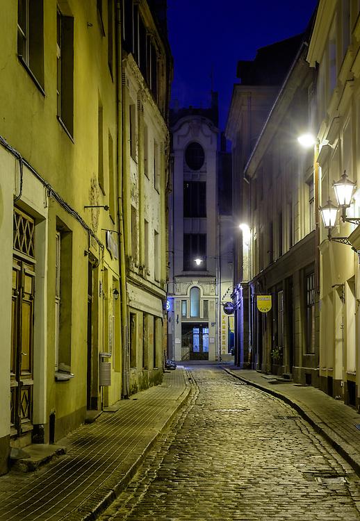 RIGA, LATVIA - CIRCA MAY 2014: View of street in Old Town Riga at night.