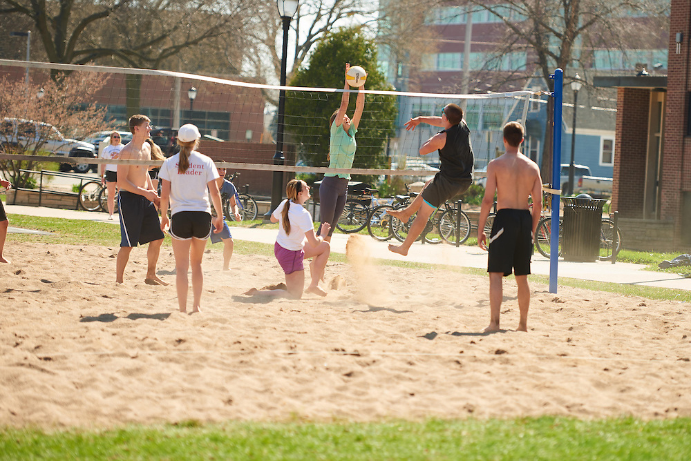 Activity; Socializing; Playing; Buildings; Eagle Hall; Location; Outside; People; Student Students; Spring; April; Time/Weather; sunny; Type of Photography; Candid; UWL UW-L UW-La Crosse University of Wisconsin-La Crosse; volleyball