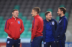 File photo dated 10-10-2016 of England's Wayne Rooney (left), Jamie Vardy (centre) and caretaker manager Gareth Southgate (right)