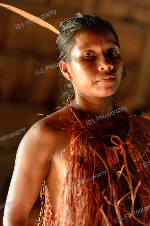 A Yagua young woman inside a maloca near Indiana on the Amazon River