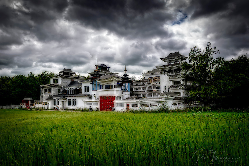 Dark clouds gather above Yangtorp, a Quigong temple in the south of Sweden.