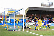 Oxford forward Danny Hylton bundles the ball over the line for the opening goal during the Sky Bet League 2 match between AFC Wimbledon and Oxford United at the Cherry Red Records Stadium, Kingston, England on 27 February 2016. Photo by David Charbit.