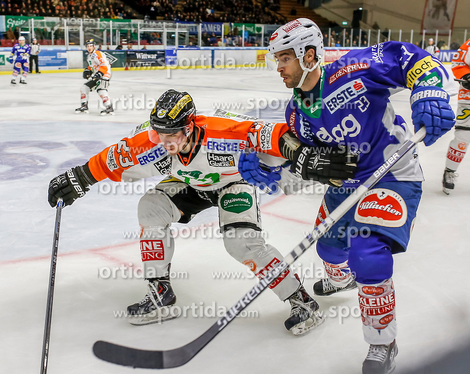 23.10.2014, Eisstadion Liebenau, Graz, AUT, EBEL, Moser Medical Graz 99ers vs EC VSV, 13. Runde, im Bild von links Mitch Ganzak (Moser Medical Graz 99ers) und Darren Haydar (EC VSV) // Mitch Ganzak (Moser Medical Graz 99ers) and Darren Haydar (EC VSV) during the Erste Bank Icehockey League 13th Round match between Moser Medical Graz 99ers and EC VSV at the Ice Stadium Liebenau, Graz, Austria on 2014/10/23, EXPA Pictures © 2014, PhotoCredit: EXPA/ Erwin Scheriau