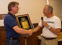 Eric Fecteau from Stafford Oil receives a placque along with thanks from Stan Brallier for his support of Got Lunch Laconia during their ice cream social on Monday afternoon.  (Karen Bobotas/for the Laconia Daily Sun)