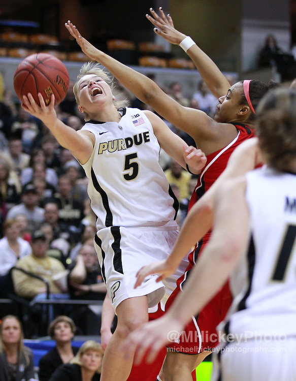 March 04, 2012; Indianapolis, IN, USA; Purdue Boilermakers guard Brittany Rayburn (5) shoots the ball against the Nebraska Cornhuskers during the finals of the 2012 Big Ten Tournament at Bankers Life Fieldhouse. Purdue defeated Nebraska 74-70 in 2OT. Mandatory credit: Michael Hickey-US PRESSWIRE