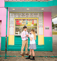 "Memphis, Tennessee- November 4, 2014: Friends make an after-school trip to Jerry's Sno Cones, which features around 70 renditions of the iconic neon confection. Customers who opt for the ""supreme"" will receive a scoop of soft serve ice cream in addition to the handcrafted syrups, which make these sno cones so popular. CREDIT: Chris Carmichael for The New York Times"