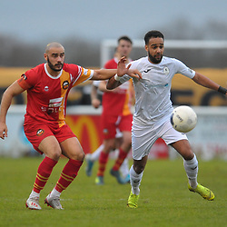 TELFORD COPYRIGHT MIKE SHERIDAN Brendon Daniels of Telford gives chase under pressure from Spencer Hamilton during the Vanarama Conference North fixture between AFC Telford United and Gloucester City at Jubilee Stadium, Evesham on Saturday, December 28, 2019.<br /> <br /> Picture credit: Mike Sheridan/Ultrapress<br /> <br /> MS201920-037