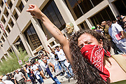 "29 JULY 2010 - PHOENIX, AZ: Jenny Sanchez (CQ) leads a chant against Sheriff Joe Arpaio on Washington St in Phoenix Thursday. Dozens of people were arrested during protests against SB 1070 across central Phoenix Thursday. US Judge Susan Bolton's ruling Wednesday stopped four of SB 1070's more than a dozen provisions from going into effect. She wrote, ""The court also finds that the United States is likely to suffer irreparable harm if the court does not preliminarily enjoin enforcement of these sections,"" she states in the ruling. ""The balance of equities tips in the United States' favor considering the public interest.""     PHOTO BY JACK KURTZ"