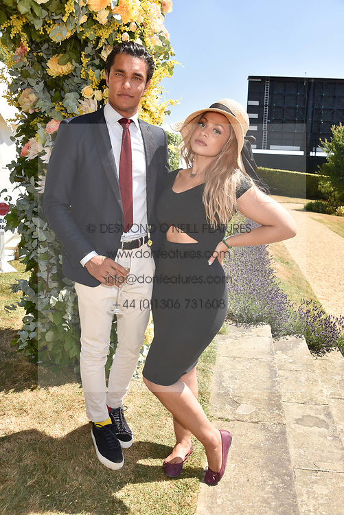 Staz Nair and his fiance at the 'Cartier Style et Luxe' enclosure during the Goodwood Festival of Speed, Goodwood House, West Sussex, England. 15 July 2018.