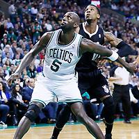 30 January 2013: Boston Celtics power forward Kevin Garnett (5) vies for the rebound with Sacramento Kings power forward Thomas Robinson (0) during the Boston Celtics 99-81 victory over the Sacramento Kings at the TD Garden, Boston, Massachusetts, USA.