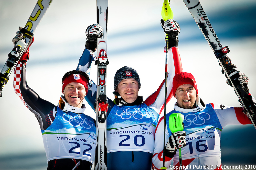 Bode Miller, USA, (C) celebrates his victory in the Men's Super Combined with silver medalist Ivica Kostelic, CRO, (L) and bronze medalist Silvan Zurbriggen, SUI, (R) during the 2010 Vancouver Winter Olympics in Whistler, British Columbia, Sunday, Feb. 21, 2010.