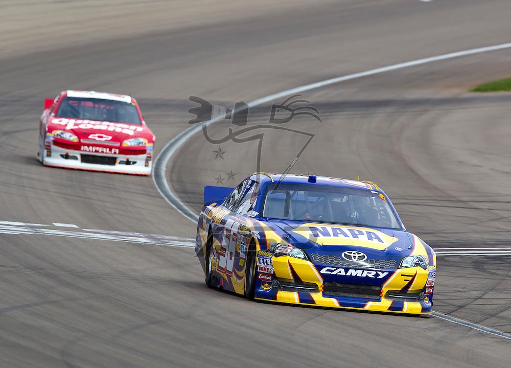 LAS VEGAS, NV - MAR 11, 2012:  Martin Truex, Jr. (56) and Ryan Newman (39) battle for position during the Kobalt Tools 400 race at the Las Vegas Motor Speedway in Las Vegas, NV.