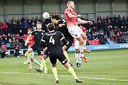 Macclesfield Town defender James Pearson head the ball during the EFL Sky Bet League 2 match between Salford City and Macclesfield Town at the Peninsula Stadium, Salford, United Kingdom on 23 November 2019.