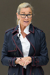 © Licensed to London News Pictures. 13/10/2016. ANGELA JEAN AHRENDTS senior vice president of retail at Apple Inc. speaks at Apple store in Regent Street is unveiled at a press preview with a new exterior and interior design concept by Foster + Partners.  Regent St was the first Apple store in Europe and has served over 60 million customers over the past 12 years. London, UK. Photo credit: Ray Tang/LNP