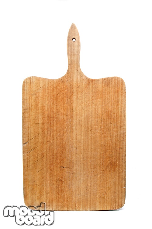 Wooden bread board on white background