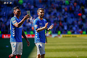 Alfredo Morelos & Daniel Candeias of Rangers FC soaking up the atmosphere following the Ladbrokes Scottish Premiership match between Rangers and Celtic at Ibrox, Glasgow, Scotland on 12 May 2019.
