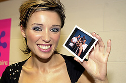Dannii Minogue excited about having had her photograph taken with boy band Blue back stage at Sheffield Arena during the Smash hits tour of October 2002