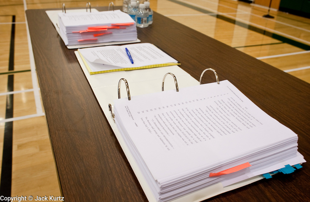 """Aug 10, 2009 -- CHANDLER, AZ: Copies of the health care reform bill on a table in a health care reform town hall meeting in Chandler, AZ. Rep. Jeff Flake, (R-AZ) hosted a """"town hall"""" style meeting on health care reform at Basha High School in Chandler Monday. Flake, a conservative Republican, has opposed President Obama on many issues, like the stimulus and health care reform. Protestors who have shut down similar meetings hosted by Democrats, gave Flake a warm welome. About 1,600 people attended the meeting.   Photo by Jack Kurtz"""