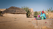 Desert woman washing cloths (India)
