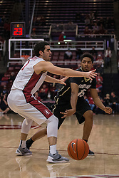 Colorado forward Wesley Gordon (1) passes the ball around Stanford guard Christian Sanders, left, during the first half of an NCAA college basketball game in Stanford, Calif., Sunday, Jan. 3, 2016. Colorado won 56-55. (AP Photo/Jason O. Watson)