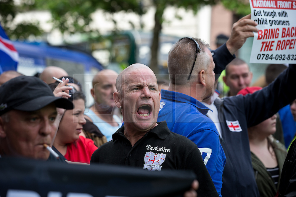 """© Licensed to London News Pictures . 22/08/2015 . Manchester , UK . Far-right nationalist group , """" North West Infidels """" and Islamophobic , anti-Semitic and white supremacist supporters , hold a rally in Manchester City Centre . Photo credit : Joel Goodman/LNP"""