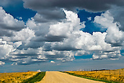 Country road and clouds<br /> Drumheller<br /> Alberta<br /> Canada