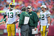 KANSAS CITY, MO - AUGUST 29:  Vince Young #13, Aaron Rodgers #12 and Head Coach Mike McCarthy of the Green Bay Packers talk during a timeout during the last preseason game against the Kansas City Chiefs at Arrowhead Stadium on August 29, 2013 in Kansas CIty, Missouri.  (Photo by Wesley Hitt/Getty Images) *** Local Caption *** Vince Young; Aaron Rodgers; Mike McCarthy
