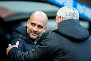 Manchester City manager Pep Guardiola shakes hands with Newcastle United manager Steve Bruce ahead of the Premier League match between Newcastle United and Manchester City at St. James's Park, Newcastle, England on 30 November 2019.
