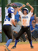 Gary Cosby Jr./ Decatur Daily     Hatton's Jami Hunter celebrates with teammate Victoria Crumpton after Crumpton scored what she thought was the game tying run against Mobile Christian during the state softball championships at Lagoon Park Friday in Montgomery.  Crumpton was sent back to third base due to a ground rule ruling.