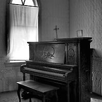 Interior of room in church with upright piano in Tunbridge, Pierce County USA