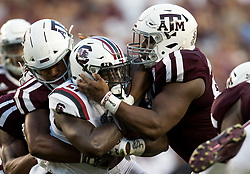 South Carolina running back Ty'Son Williams (27) fights for yards against Texas A&M defensive lineman Justin Madubuike (95) during the first quarter of an NCAA college football game Saturday, Sept. 30, 2017, in College Station, Texas. (AP Photo/Sam Craft)