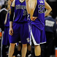15 March 2009:   Sacramento Kings forward Andres Nocioni (5) shows guard Francisco Garcia (32) how close he was to making a three point shot to tie the game with 3.8 seconds remaining.  Garcia was credited with a 2-point shot at the Verizon Center in Washington, D.C. as the Wizards defeated the Kings 106-104.