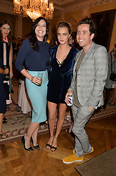 Left to right, DAISY LOWE, CARA DELEVINGNE and NICK GRIMSHAW  at a party hosed by the US Ambassador to the UK Matthew Barzun, his wife Brooke Barzun and editor of UK Vogue Alexandra Shulman in association with J Crew to celebrate London Fashion Week held at Winfield House, Regent's Park, London on 16th September 2014.
