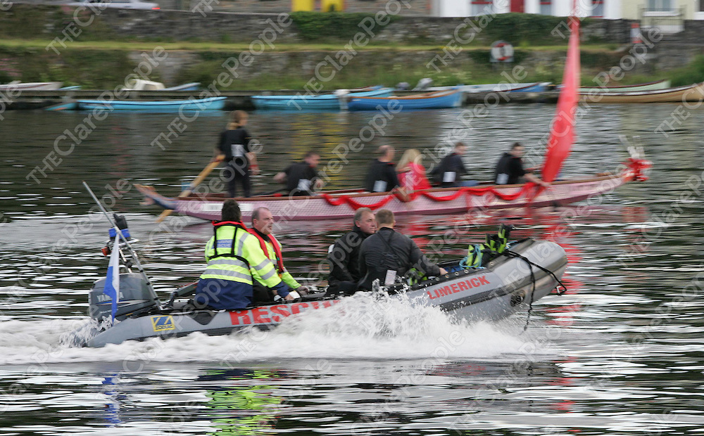 Members of Limerick Search &amp; Rescue speed passed a Dragon Boat part of the weekends Brian Boru Pageant as they travel to assist in the search for the man who fell overboard from a boat on Lough Derg north of Killaloe on Saturday afternoon.<br /> Picture: Liam Burke/Press 22