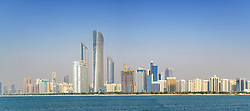 Skyline of modern skyscrapers along Corniche in Abu Dhabi United Arab Emirates