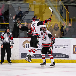 GEORGETOWN, ON - MARCH 2: Jaden Condotta #40 of the Georgetown Raiders jumps into the arms of Matt McJannet #12 of the Georgetown Raiders while celebrating a goal March 2, 2019 at Gordon Alcott Memorial Arena in Georgetown, Ontario, Canada.<br /> (Photo by Dave Fryer / OJHL Images)