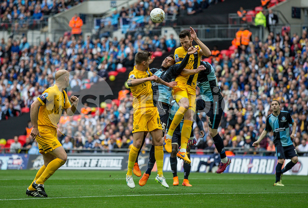 Cian Bolger of Southend United heads clear during the Sky Bet League 2 Play-Off Final match between Southend United and Wycombe Wanderers at Wembley Stadium, London, England on 23 May 2015. Photo by Liam McAvoy.