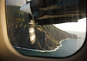 Final approach in a Twin Otter along the dramatic and uninhabited north coast of Saba.  The landing is on the shortest commercial airstrip in use in the world.