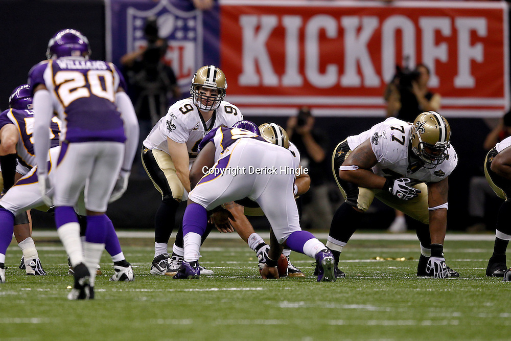 September 9, 2010; New Orleans, LA, USA;  New Orleans Saints quarterback Drew Brees (9) under center during the NFL Kickoff season opener at the Louisiana Superdome. The New Orleans Saints defeated the Minnesota Vikings 14-9.  Mandatory Credit: Derick E. Hingle