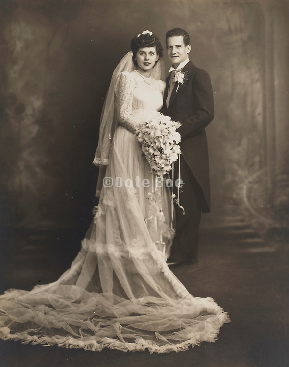 Formal portrait of marrying couple.