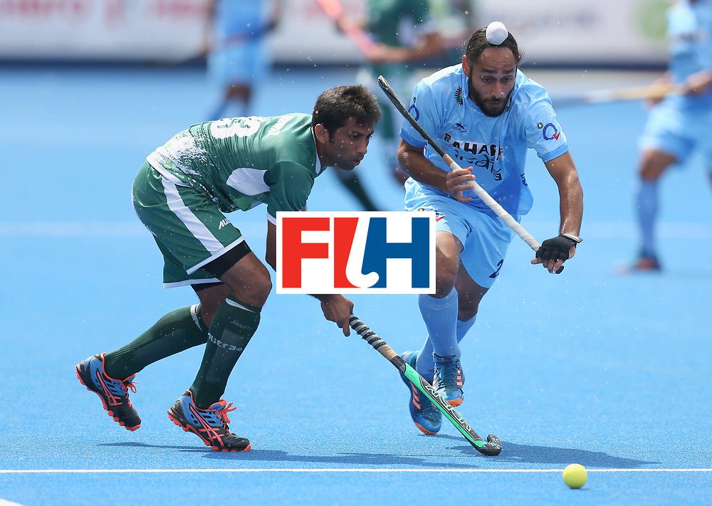 LONDON, ENGLAND - JUNE 24: Satbir Singh of India and Niwaz Ashfaq of Pakistan battle for possession during the 5th-8th place match between Pakistan and India on day eight of the Hero Hockey World League Semi-Final at Lee Valley Hockey and Tennis Centre on June 24, 2017 in London, England. (Photo by Steve Bardens/Getty Images)