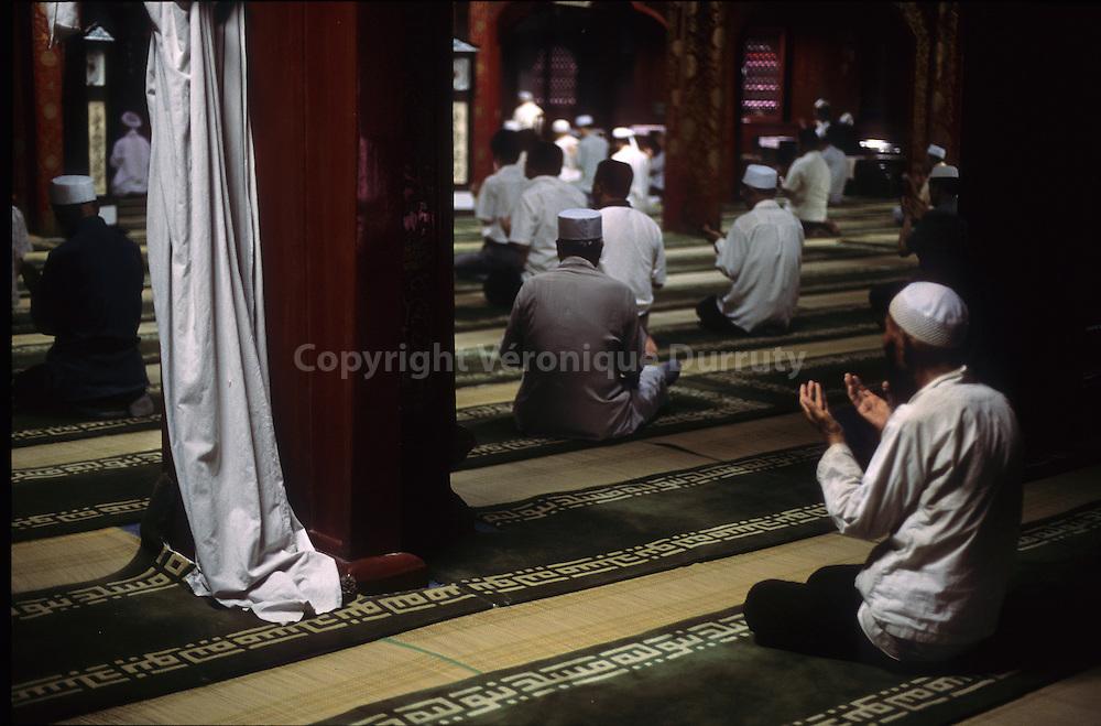 PRAYER TIME. BEIJING MOSQUE, CHINA