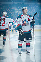 KELOWNA, CANADA - MARCH 7: Colten Martin #8 of Kelowna Rockets takes part in a pre-game ritual against the Spokane Chiefs on March 7, 2015 at Prospera Place in Kelowna, British Columbia, Canada.  (Photo by Marissa Baecker/Shoot the Breeze)  *** Local Caption *** Colten Martin;